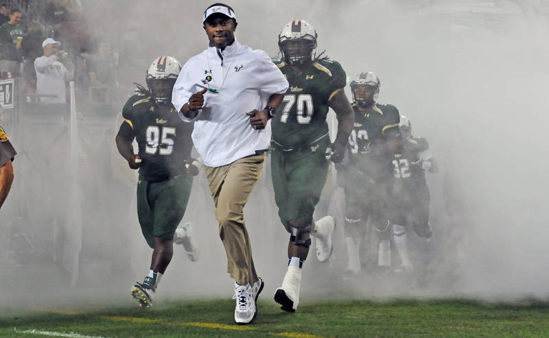 Coach Taggart walks on the field through smoke vs Memphis 2013 | SoFloBulls.com by Matthew Manuri|